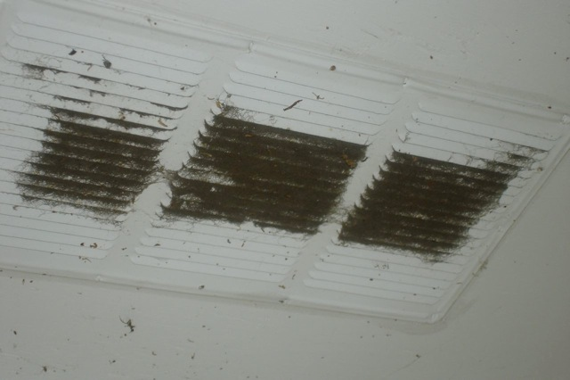 Hole cut too small behind soffit vent